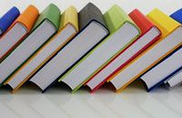 books of different colors on the self
